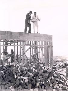 Two Men Going over Blueprints