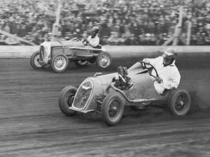 Two Men Racing Midget Cars