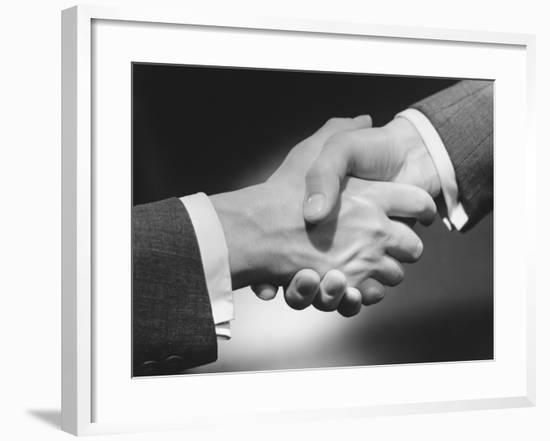 Two Men Shaking Hands, Close-Up of Hands-George Marks-Framed Photographic Print