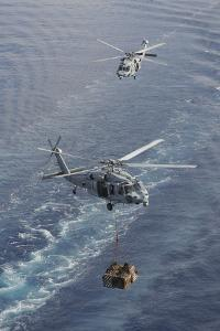 Two Mh-60S Sea Hawk Helicopters Transport Supplies