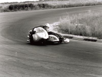 Two Motorcyclists in a Race, on a Two Seater Motorcycle-A^ Villani-Photographic Print