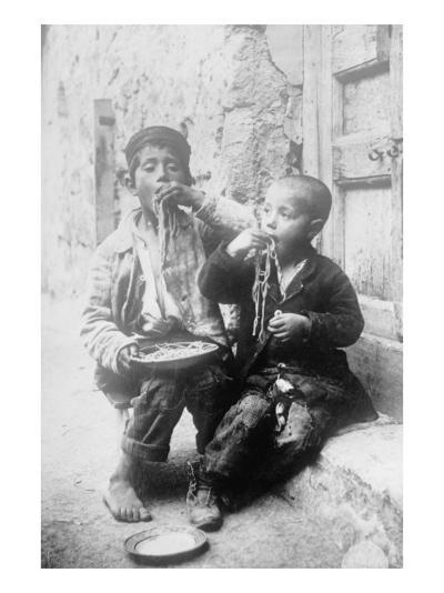 Two Neapolitan Children Slurp Down Spaghetti--Art Print
