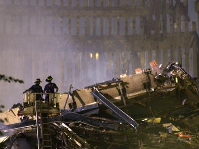 Two New York Firefighters View the Smoldering Rubble