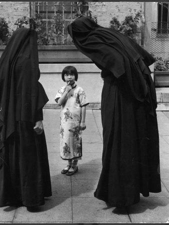 https://imgc.artprintimages.com/img/print/two-nuns-questioning-a-little-chinese-girl-at-the-american-mission-school_u-l-p74p140.jpg?p=0