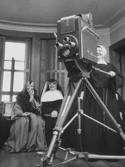 Two Nuns Smiling from the Wings While the Third Is Operating the Large TV Camera--Photographic Print