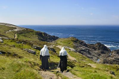 Two Nuns Walking on a Beach in Ireland-Chris Hill-Photographic Print