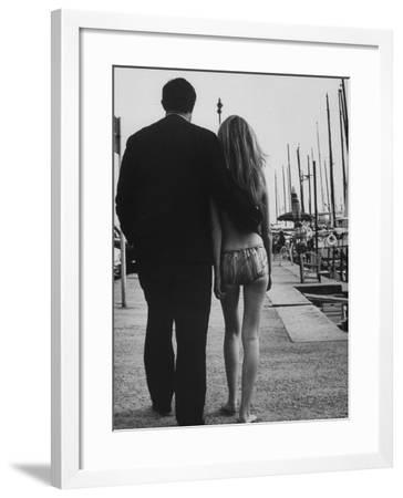 Two People at the Cannes Film Festival-Paul Schutzer-Framed Photographic Print