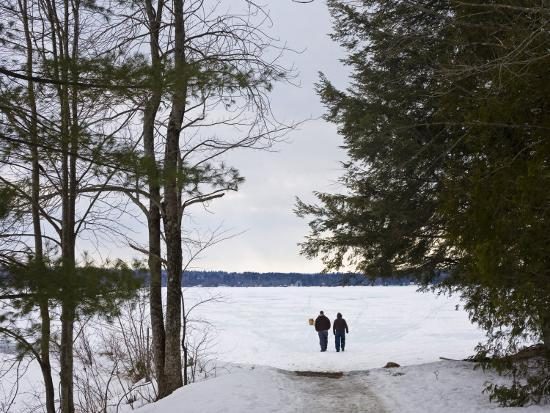 Two People Walk Out onto the Frozen Lake to Go Ice Fishing-Hannele Lahti-Photographic Print