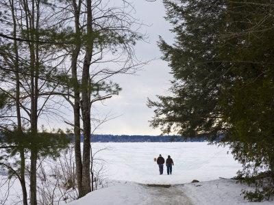 https://imgc.artprintimages.com/img/print/two-people-walk-out-onto-the-frozen-lake-to-go-ice-fishing_u-l-p8g6k10.jpg?p=0