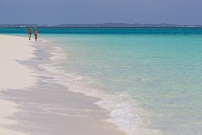 Two People Walking Down the Beach at Grace Bay on the Caribbean Sea-Mike Theiss-Photographic Print