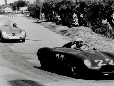Two Racing Cars Whizzing by on a Road-A^ Villani-Photographic Print