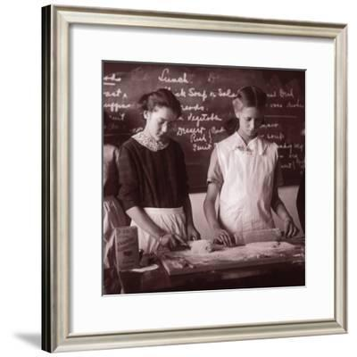 Two School Girls Baking in Home Economics Class