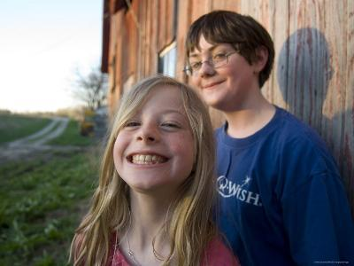 Two Siblings Play near an Old Barn in Nebraska-Joel Sartore-Photographic Print