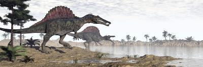 Two Spinosaurus Dinosaurs Walking to the Water in a Desert Landscape--Art Print