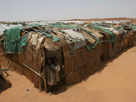 Two Sudanese Boys Stand by Makeshift Huts--Photographic Print