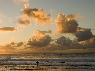 Two Surfers Enter the Pacific Ocean as the Sun Sets in Hawaii-Charles Kogod-Photographic Print