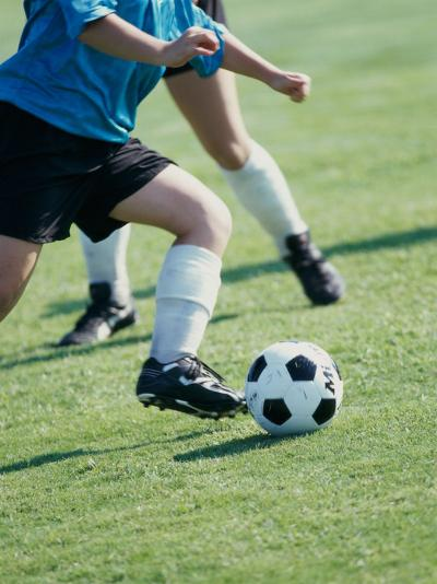 Two Teenagers Playing Soccer--Photographic Print
