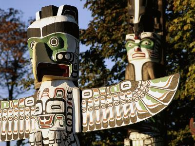 Two Totem Poles, Stanley Park, Vancouver, British Columbia, Canada-Walter Bibikow-Photographic Print