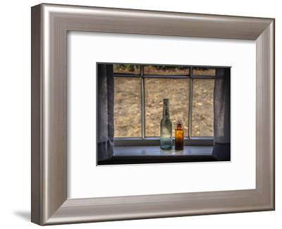 Two vintage bottles on window sill.-Sheila Haddad-Framed Photographic Print
