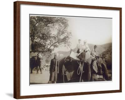 Two Well-Dressed English Women Riding on an Elephant, with the Aid of Young Indian Men--Framed Photographic Print