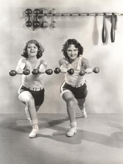 Two Women Exercising with Dumbbells at Gym--Photo