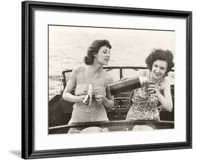 Two Women Having a Snack on Motorboat--Framed Photo