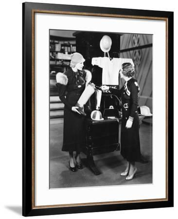 Two Women in a Store Looking at the Display--Framed Photo