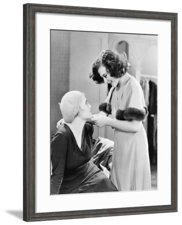 Two Women Intimately Looking at Each Other--Framed Photo