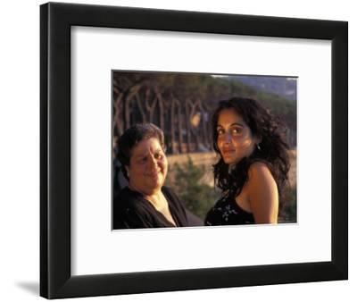 Two Women Look Out During Sunset in Naples, Italy-Richard Nowitz-Framed Photographic Print
