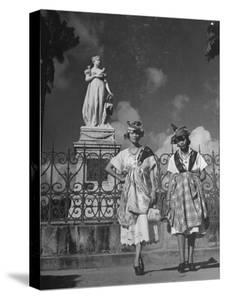 Two Women Standing in Front of a Statue of the Empress Josephine on the Island of Martinique