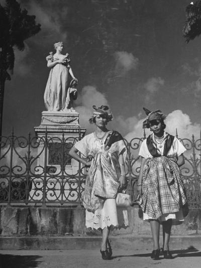 Two Women Standing in Front of a Statue of the Empress Josephine on the Island of Martinique--Photographic Print