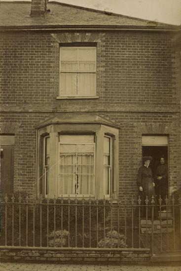 Two Women Standing in the Doorway of a Semi-Detached House--Photographic Print