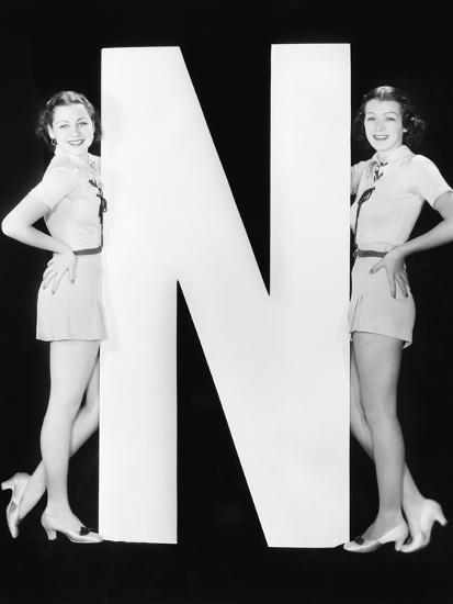Two Women with Huge Letter N-Everett Collection-Photographic Print