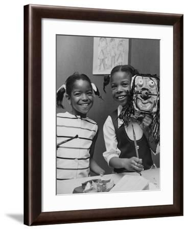 Two Young Girls Working on Papier Mache Art Pieces, Chicago Public Schools Art Fair--Framed Photographic Print