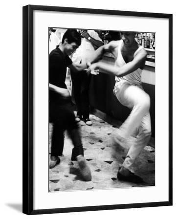 Two Young Italian Men Dancing to Music from a Jukebox in a Bar-Paul Schutzer-Framed Photographic Print