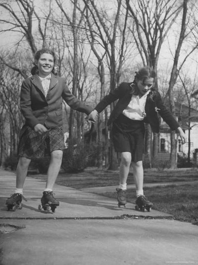 """Typical 10 Year Old Girls Known as """"Pigtailers"""" Roller Skating-Frank Scherschel-Photographic Print"""
