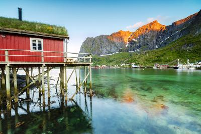 Typical House of Fishermen Called Rorbu Lit Up by Midnight Sun, Reine, Nordland County-Roberto Moiola-Photographic Print