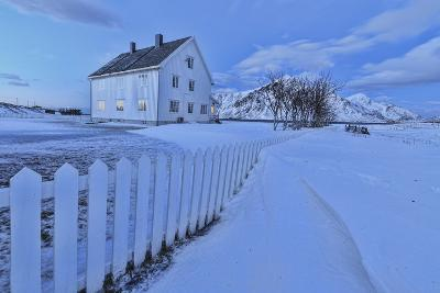 Typical House Surrounded by Snow at Dusk, Flakstad, Lofoten Islands, Norway, Scandinavia-Roberto Moiola-Photographic Print