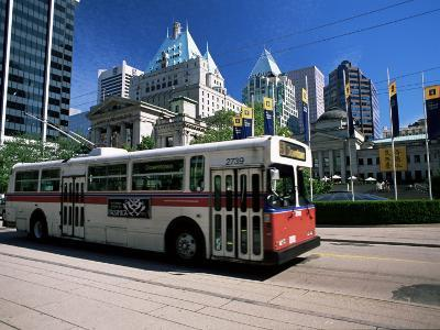 Typical Red and White Bus, Robson Square, Vancouver, British Columbia, Canada-Ruth Tomlinson-Photographic Print