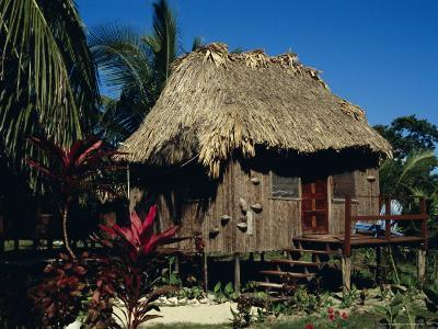 Typical Thatched Wooden Hut on the Island, Caye Caulker, Belize, Central America-Christopher Rennie-Photographic Print