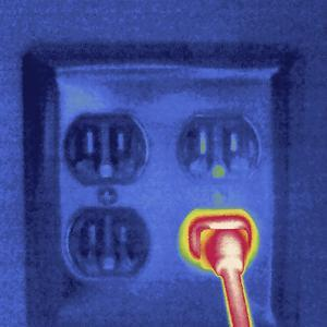 Thermal Image of a Plug in a Socket by Tyrone Turner