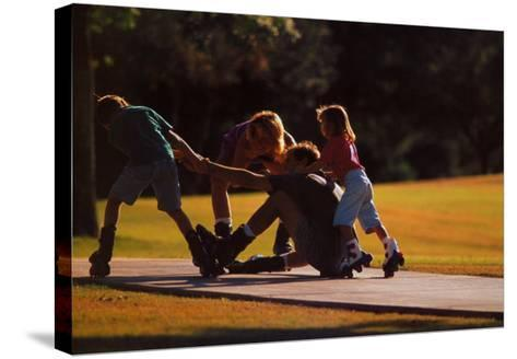 Teamwork: Family of Skaters--Stretched Canvas Print