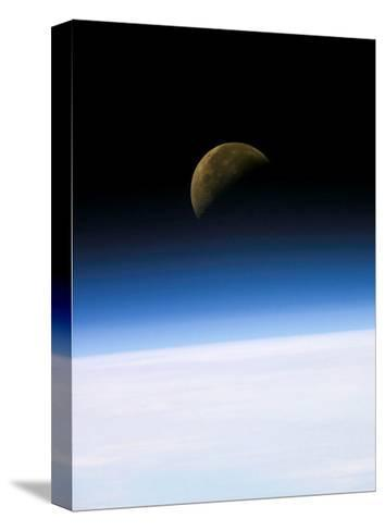 Space Shuttle View of Earth and Moon--Stretched Canvas Print