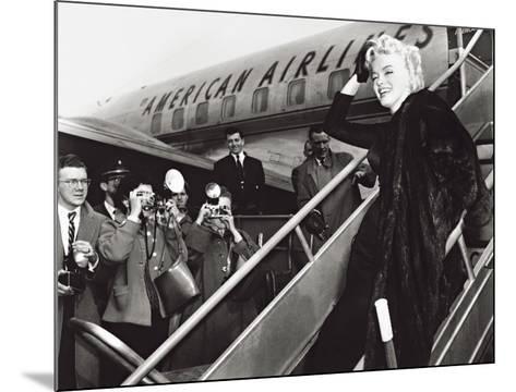 Marilyn Monroe Boards Airplane, New York, c.1956--Mounted Art Print