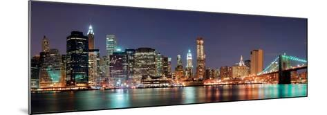New York City - Manhattan Skyline Panorama with Brooklyn Bridge at Night--Mounted Art Print