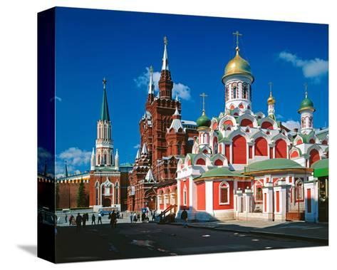 Orthodox Church with State Historical Museum and Kremlin Tower on Red Square, Moscow, Russia--Stretched Canvas Print