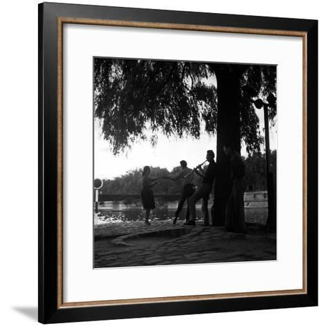 Rock 'n' Roll Dancers on the Square du Vert-Galant, Paris, 1960-Paul Almasy-Framed Art Print