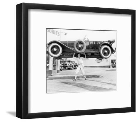 Strong Man Lifting A Car Over His Head--Framed Art Print