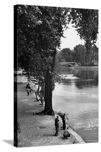 Men Fishing along the Seine-Jules Dortes-Stretched Canvas Print