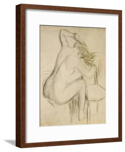 A Seated Woman Styling Her Hair-Edgar Degas-Framed Art Print